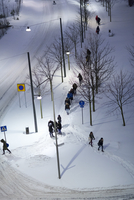 High angle view of people walking in winter evening