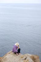 Girl sitting at water
