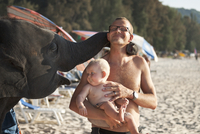 Father with baby on beach