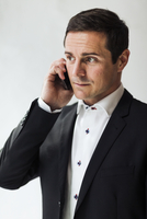 Mid adult businessman using cell phone