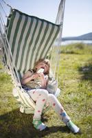 Girl sleeping on hammock with ice-cream