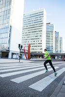 Man running through zebra crossing