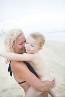 Mother with child on beach