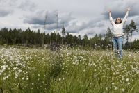 Smiling woman on blossoming meadow