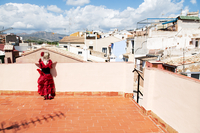 Girl in red dress on terrace