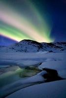 Aurora Borealis over Mikkelfjellet Mountain in Troms County,