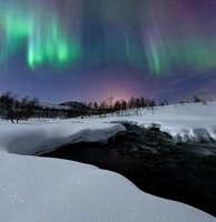 Aurora Borealis over Blafjellelva RIver in Troms County, Nor