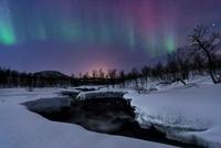 Aurora Borealis over Blafjellelva RIver in Troms County, Nor