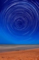 Star trails around the south celestial pole at the beach in
