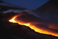 Mount Etna lava flow at night, Sicily, Italy.