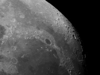Close-up view of the moon showing impact crater Plato.