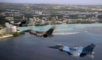 Three F-16 Fighting Falcons fly in formation over Tumon Bay,