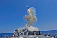 USS Barry launches a Tomahawk cruise missile.