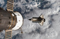 Space Shuttle Atlantis and the docked Soyuz spacecraft.