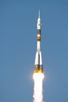 The Soyuz TMA-12 spacecraft lifts off into a cloudless sky.