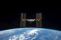 The International Space Station backdropped by Earth's horiz