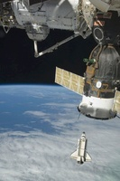 Space shuttle Endeavour, a Soyuz spacecraft, and the Interna