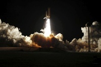 Space shuttle Discovery lifts off from Launch Pad 39A at Ken