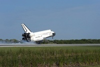 Space shuttle Discovery lands on Runway 33 at the Shuttle La