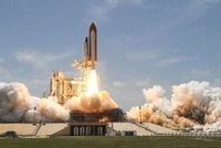 Space shuttle Atlantis lifting off from Launch Pad 39A at th