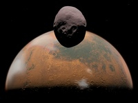 Artist's concept of Mars and its tiny moon Phobos.