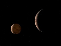 Artist's concept of Pluto and its moon Charon.