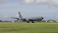A KC-135 Stratotanker lands on the runway at Kadena Air Base