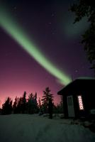 Aurora borealis above cabin, Northwest Territories, Canada.