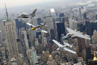 A P-51 Mustang, an F-16 Fighting Falcon, an F-15 Eagle, and