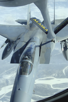 A F-15 Eagle receives fuel from a KC-135 Stratotanker.