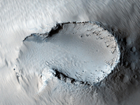 A small cone on the side of one of Mars' giant shield volcan