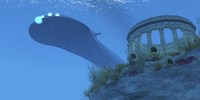 A submarine passes over a Greek temple ruin near a reef.