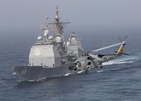 A SH-60J Seahawk flys by USS Vicksburg during a vertical replenishment.