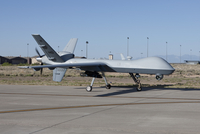An MQ-9 Reaper taxi's to the runway at Holloman Air Force Base.