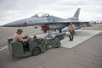 Weapons loaders prepare to load a GBU-38 JDAM on an F-16.