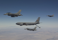 Three F-16's join up with a KC-135 over Arizona.