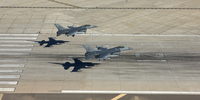 Two F-16's land in formation at Luke Air Force Base, Arizona.