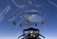 An F-15 Eagle pulls into position behind a KC-135 Stratotanker