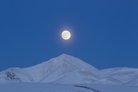 Full moon over Ogilvie Mountains, Canada.