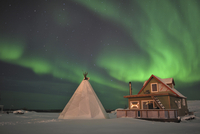 Northern Lights above village, Northwest Territories, Canada.