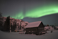 Aurora borealis over a cabin, Northwest Territories, Canada.