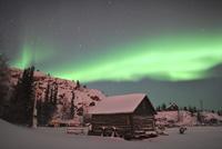 Aurora borealis over a cabin, Northwest Territories, Canada.