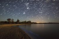 Star trails and bioluminescence, Gippsland Lakes, Australia.