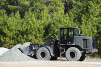 Equipment Operator gathers a load of gravel on Camp Johnson.