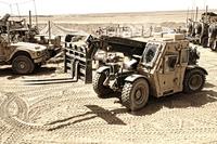 A Combat Logistics Battalion multi-mission vehicle unloads supplies.
