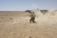 U.S. Marines fire several high-explosive rockets in the Middle East.