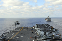 An MH-60S Sea Hawk takes off from the flight deck of USS Bonhomme Richard.