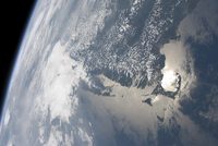 Sunglint on the waters of Earth.