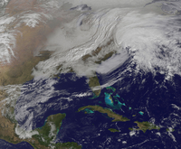Two low pressure systems merging over the United States east coast.