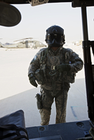 U.S. Army UH-60L Loadmaster confirms pre-fliight check on his aircraft.